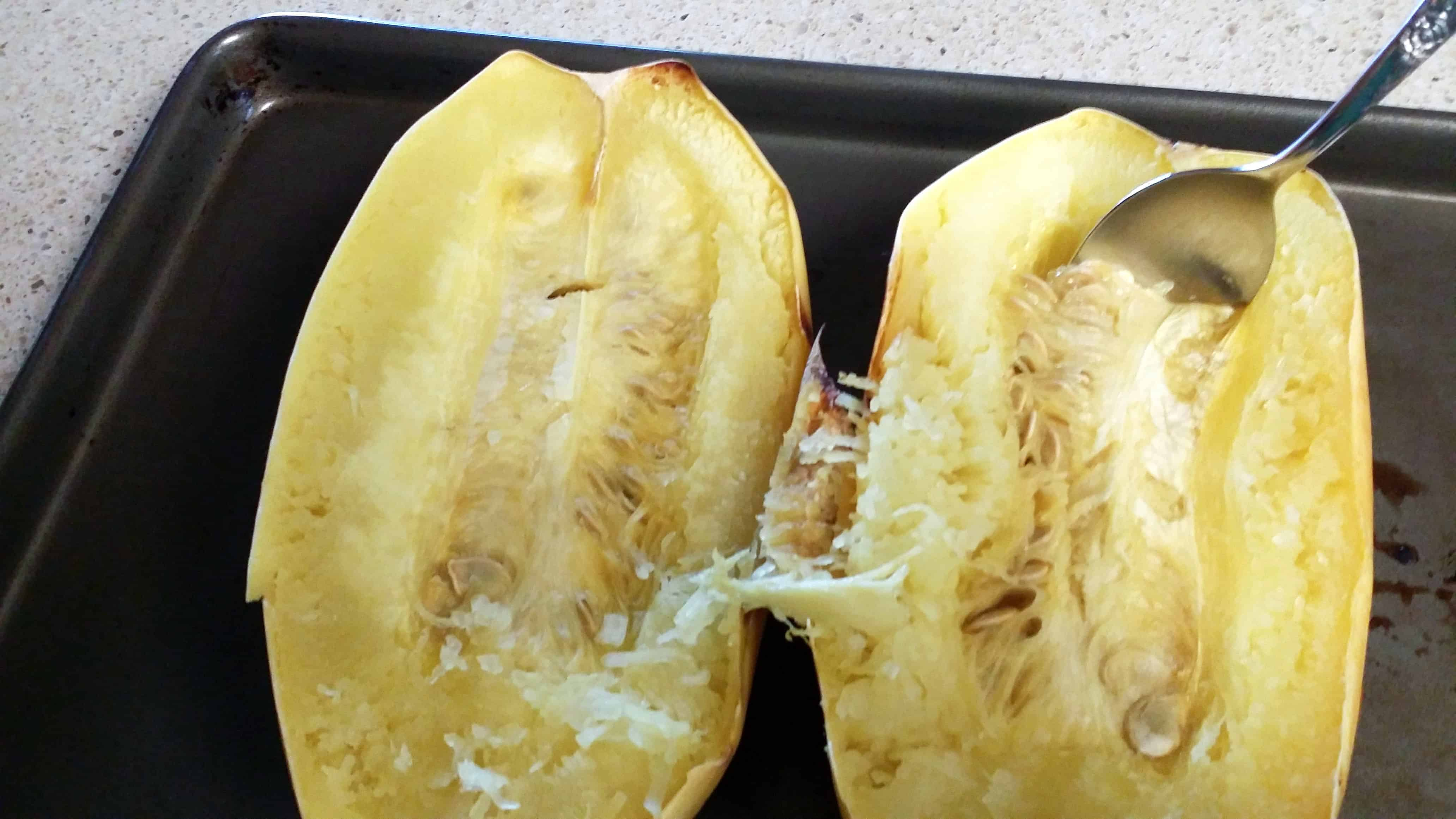 Scoop seeds out of spaghetti squash