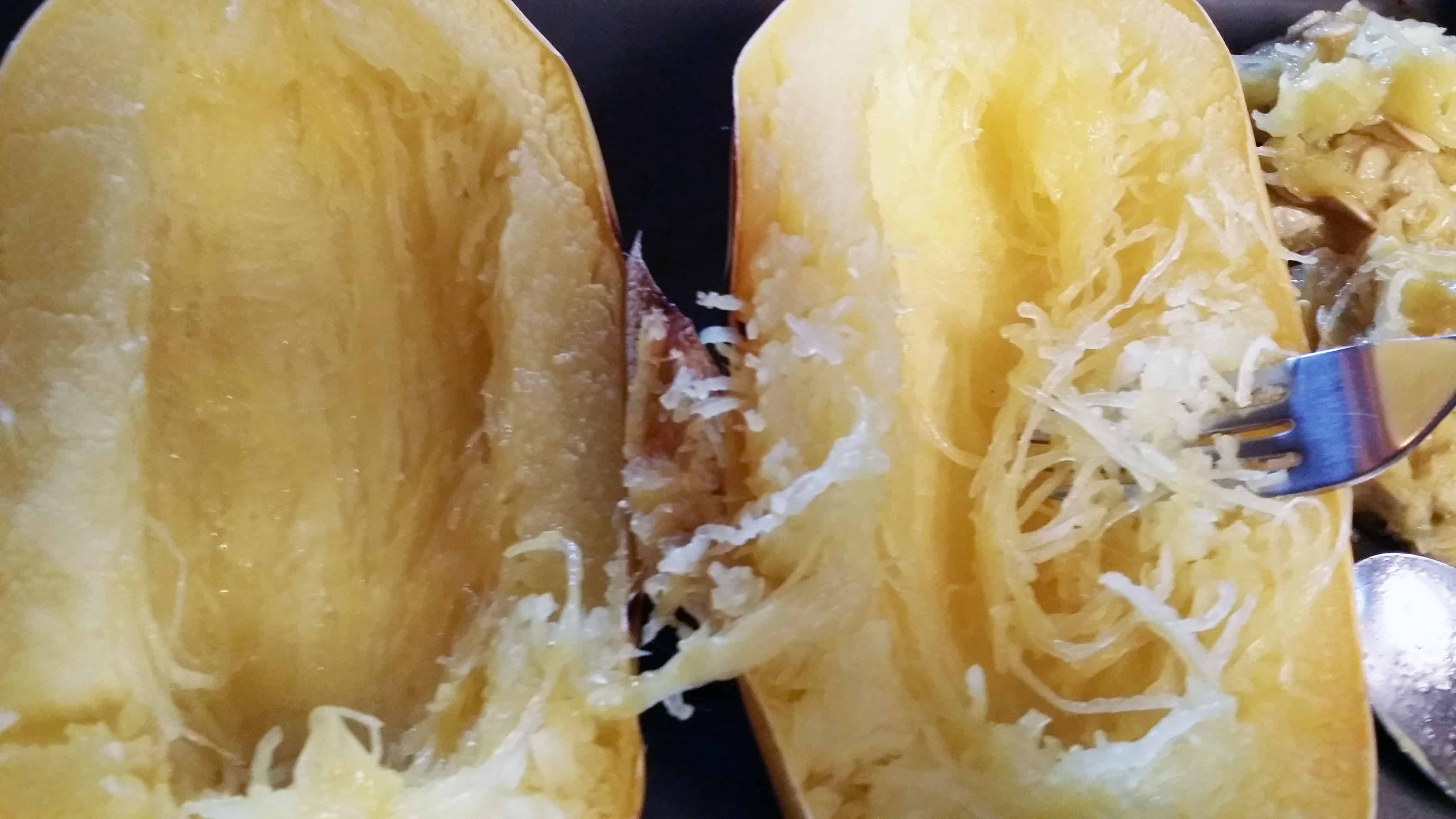 Separate strands of spaghetti squash with a fork