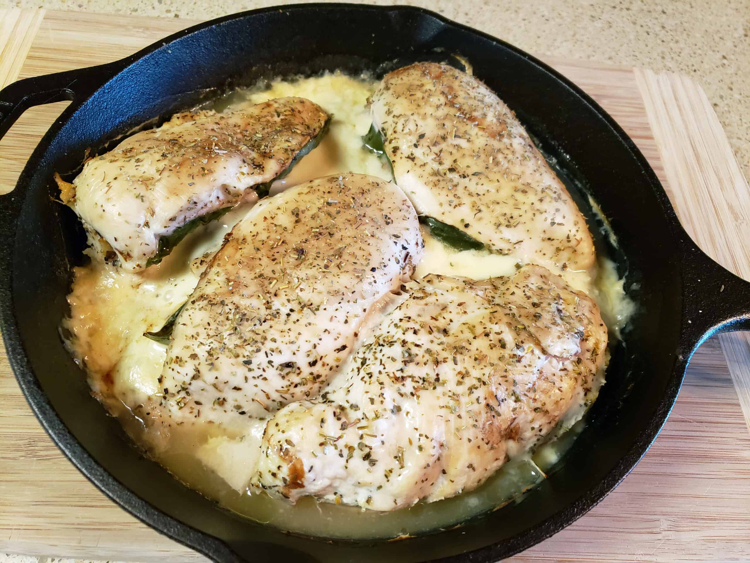 baked stuffed chicken in cast iron skillet