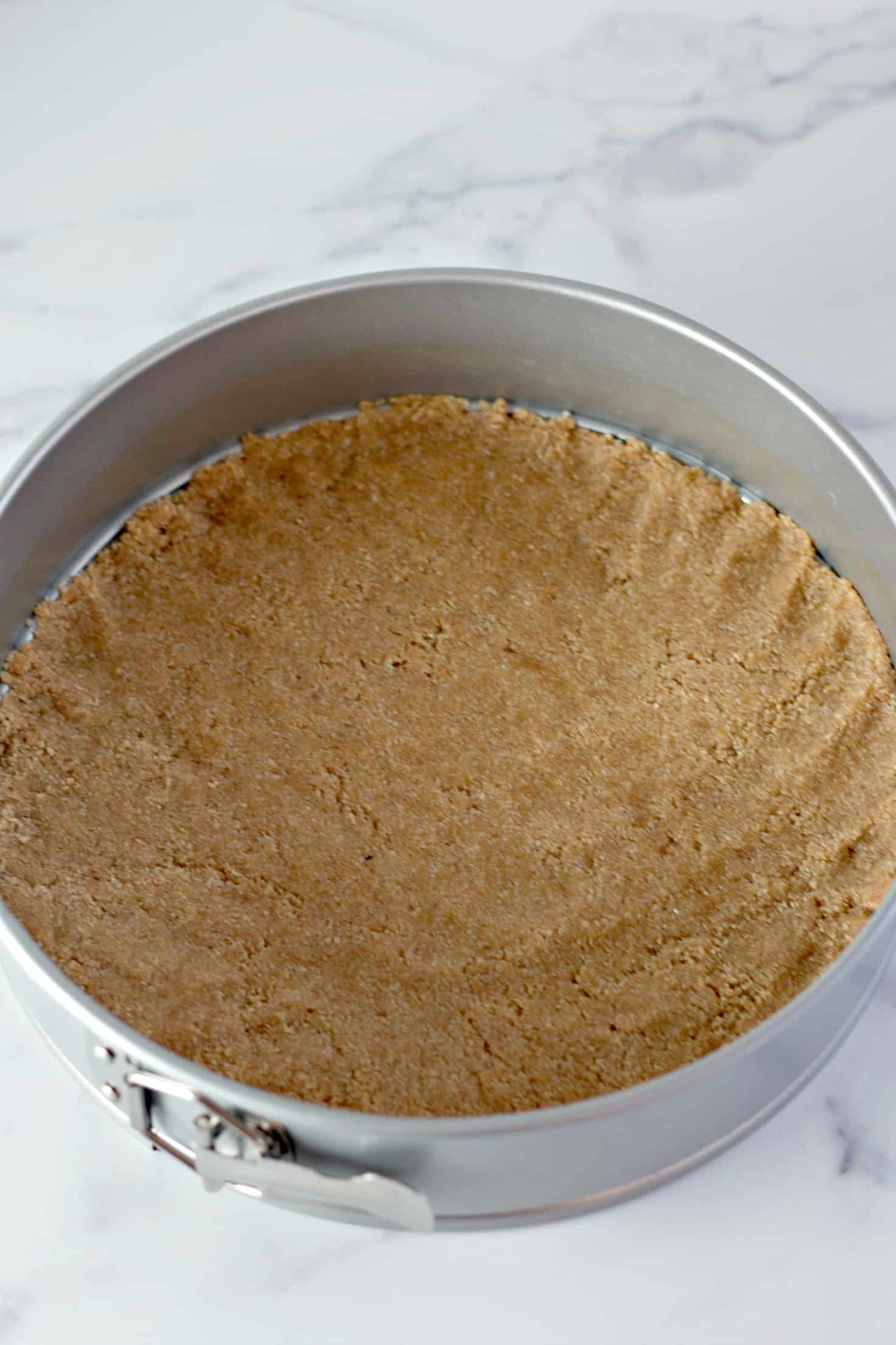 Crust in the springform pan for keto pumpkin cheesecake